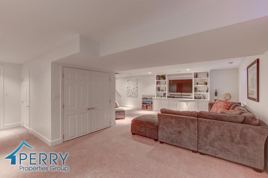 5153 W Fair Ave Littleton CO-large-004-38-Lower Family Room-1500x1000-72dpi